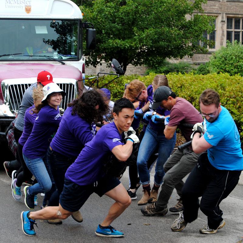 Team pulling bus